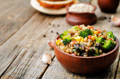 Barley porridge with corn, broccoli, garlic, mushrooms and peppe Royalty Free Stock Images