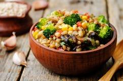 Barley porridge with corn, broccoli, garlic, mushrooms and peppe Royalty Free Stock Photo