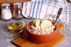 Barley porridge with egg and onion. Close up, horizontal Stock Images