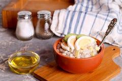 Barley porridge with egg and onion. Close up, horizontal Stock Photography