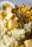 Barley porridge with eggs, cheese closeup Royalty Free Stock Photography