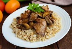 Barley porridge, fried mushrooms and duck liver, boiled quail eggs, tomatoes, arugula - healthy food Royalty Free Stock Images