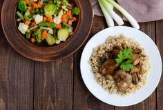 Barley porridge, fried mushrooms, duck liver and steamed summer vegetables - healthy food Royalty Free Stock Photo
