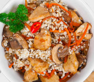 Barley porridge with, meat, mushrooms and carrots Stock Image