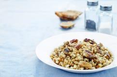 Barley porridge with mushrooms Royalty Free Stock Images