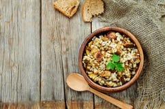 Barley porridge with mushrooms Stock Photos