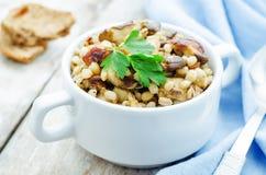 Barley porridge with mushrooms Royalty Free Stock Photo