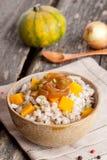 Barley porridge with vegetables Stock Photos