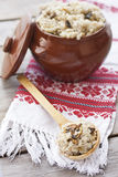 Barley porrige with mushrooms. Russian barley porrige with mushrooms in ceramic pot Royalty Free Stock Photo