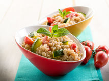 Barley risotto with zucchinis Royalty Free Stock Photos