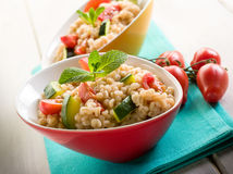 Barley risotto with zucchinis Royalty Free Stock Image