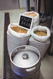 Barley in sack with keg at brewery Royalty Free Stock Photography