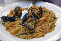 Barley seafood with mussels and shrimps closeup. Stock Photography