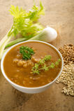 Barley soup. On bowl on wood background Royalty Free Stock Photography