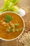 Barley soup. On bowl on wood background Stock Photo
