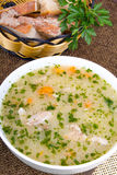 Barley soup with meat in a white bowl Stock Photo