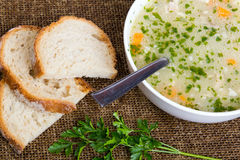 Barley soup with meat in a white bowl Royalty Free Stock Image