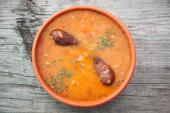 Barley soup with pork sausage Royalty Free Stock Images