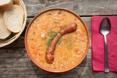 Barley soup with sausage Stock Photos