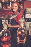 Barmaid behind bar counter Royalty Free Stock Images
