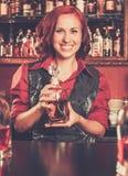 Barmaid behind bar counter Royalty Free Stock Photo