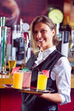 Barmaid holding tray of cocktails Stock Photos