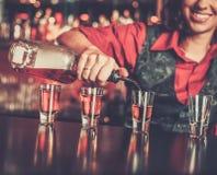 Barmaid making shots Royalty Free Stock Photo