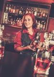 Barmaid making shots Royalty Free Stock Images