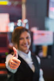 Barmaid showing thumbs up to camera Royalty Free Stock Images