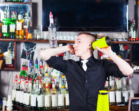 Barman in action Royalty Free Stock Images