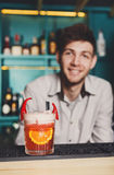 Barman amd creative spicy cocktail in night club bar background Royalty Free Stock Photo