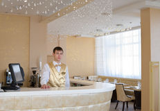 Barman at bar in respectable restaurant Royalty Free Stock Image