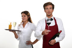 Barman and barmaid. Working together Royalty Free Stock Photos