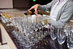Barman or bartender pours alcohol into glasses in the restaurant Royalty Free Stock Photography