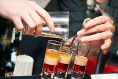 Barman or bartender preparing alcohol cocktail in restaurant Stock Photography