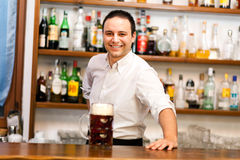 Barman with a beer Royalty Free Stock Photography