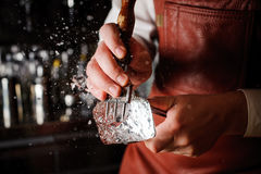 Free Barman Breaking Ice With Pick Stock Image - 74848731