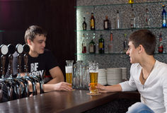 Barman chatting to a customer Stock Image