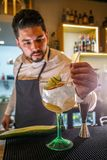 Barman is decorating cocktail Stock Photos