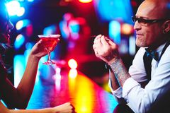 Barman and girl Royalty Free Stock Images
