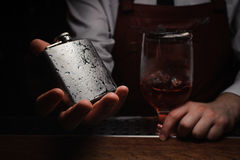 Barman holding ice cold flask. No face royalty free stock photos