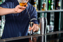 Barman makes cocktail on the counter Royalty Free Stock Photos