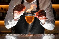 Free Barman Making An Alcoholic Drink With A Smoky Note Stock Image - 105268221