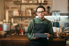 Barman making check in cafe Royalty Free Stock Image