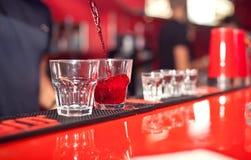 Barman making cocktail Stock Image