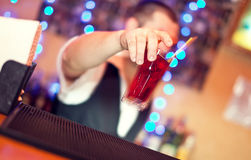 Barman making cocktail Royalty Free Stock Image