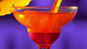 Barman making cocktail drink using ice and two. Barman`s hand making cocktail drink using cubes of ice and two types of clear liquid, sweet syrup in unusual stock video footage