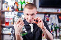 Barman making cocktail drinks Stock Photo