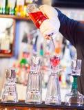 Barman making cocktail drinks Royalty Free Stock Image