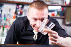 Barman making cocktail drinks Stock Image